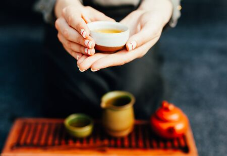 Chinese tea ceremony Asian wooden table board chaban top view copy space morning energy. Breakfast green hot drink with caffeine traditional classic crockery tea set clay ceramic pot cups nature woods Stok Fotoğraf