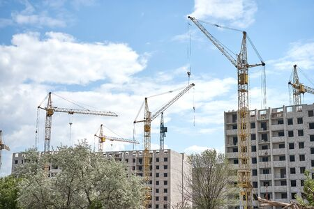 Crane building construction site blue cloudy sky background Construction  brick multi-storey building. New residential area for living