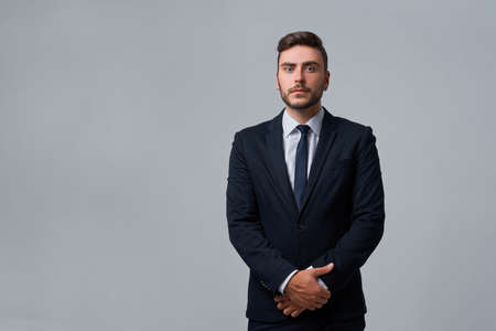 Businessman Business person. Man business suit studio gray background. Modern millenial person stylish haircut earring in ear. Portrait of charming successful young entrepreneur