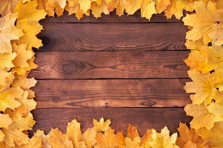 Autumn leaves Square frame on wooden background top view Fall Border yellow and Orange Leaves vintage wood table Copy space for text Foto de archivo