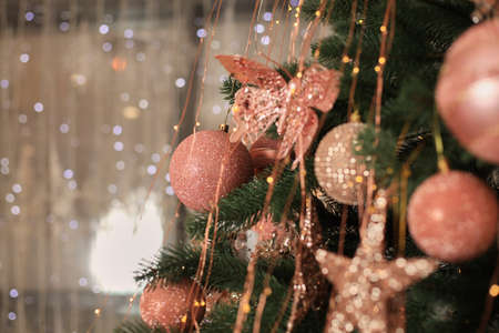 Christmas tree blur garland close-up New year background Decoration with snow and branch of Christmas tree