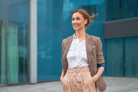 Businesswoman successful woman business person standing outdoor corporate building exterior Smile happy caucasian confidence professional business woman middle age female entrepreneur Bank employee