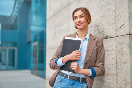 Businesswoman successful woman business person standing outdoor corporate building exterior Pensive elegance cute caucasian confidence professional business woman middle age female Bank worker
