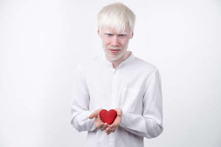 albinism albino man in studio dressed t-shirt isolated on a white background. abnormal deviations. unusual appearance. skin abnormality