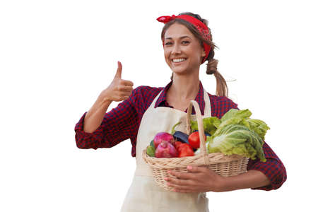 Woman dressed apron white background Farmer vegetables basket Agricultural concept Caucasian middle age Female business owner in uniform Happy one person smiling Time to advertise Banner Thumb up