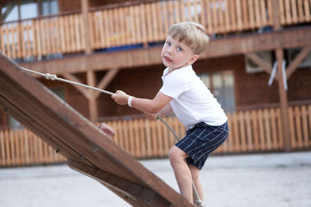 Boy play playground Child climbing rope outdoor Children healthy summer activity Healthy growth 스톡 콘텐츠 - 164896057