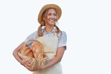 Woman dressed apron white background Farmer bread basket Agricultural concept Caucasian middle age Female business owner in uniform Happy one person smiling Time to advertise Banner Thumb up