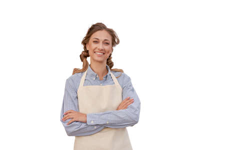 Woman dressed apron white background Caucasian middle age female business owner in uniform hands crossed Happy one person smiling Time to advertise Small business 스톡 콘텐츠