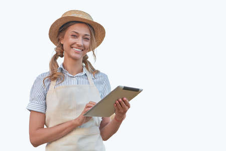 Woman dressed apron with digital tablet isolated white background Farmer agricultural Caucasian middle age Female business owner Happy one person smiling Time to advertise Concept web banner 스톡 콘텐츠 - 164976640