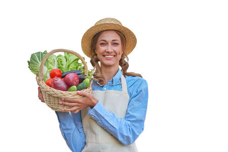 Woman dressed apron white background Farmer vegetables basket Agricultural concept Caucasian middle age Female business owner in uniform Happy one person smiling Time to advertise Banner