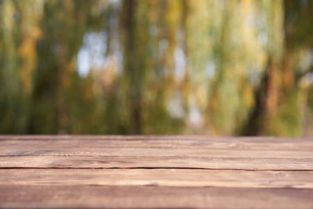 Empty wooden table nature bokeh background with a country outdoor theme, Template mock up for display of product Copy space
