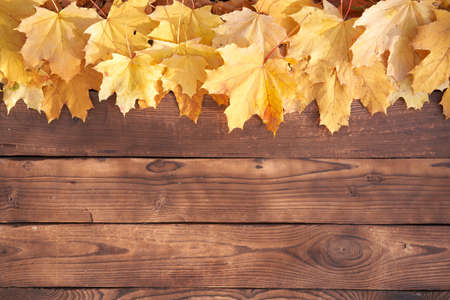 Autumn leaves frame on wooden background top view Fall Border yellow and Orange Leaves vintage wood table Copy space for text 스톡 콘텐츠