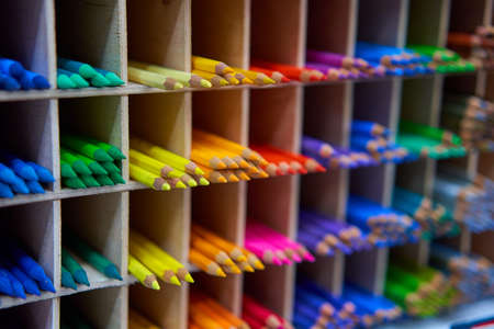 Showcase with colored pencils for drawing in the store for artists or stationery Art concept background