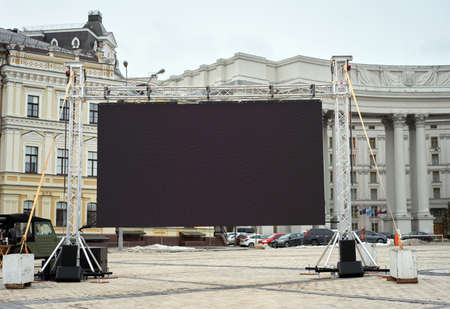 Big led panel screen standing outdoor on city street Kiev Advertisment mock up concept monitor Banque d'images