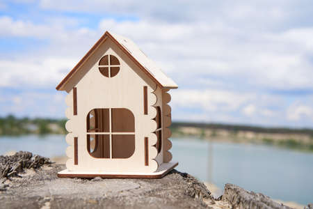 Miniature wooden house outdoor nature. Real estate concept. Modern housing. Eco-friendly energy efficient house. Buying home outside the city Fresh air. Mortgage, loan. Banque d'images