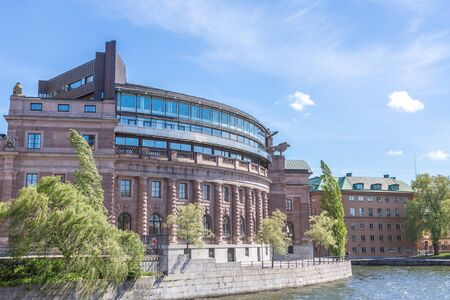 A SideView of the Swedish Parliament Building Riksdagen with a Blue Cloudy Sky in the Background photo