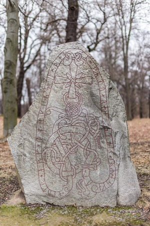 viking: Ancient Nordic Runestone Standing in the Forest Close to Karlberg Castle Sweden