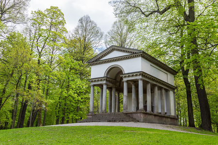 View of an Ancient Greco-Roman Temple in the Forest photo