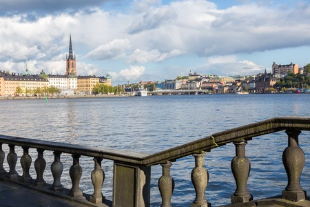 View of Riddarholmen, Stockholm, with Water and a Cloudy Sky photo