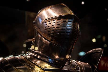 Medieval like armour suit and helmet glowing in the dark.