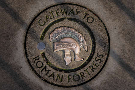 Engraved stone of Gateway to Roman Fortress in York with a roman soldier helmet