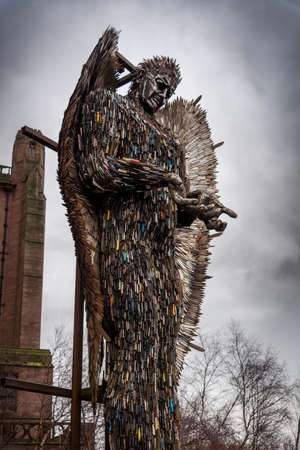 LIVERPOOL, ENGLAND, DECEMBER 27, 2018: Sculpture of an angel made with all kind of knives at the entrance of the Church of England Anglican Cathedral of the Diocese of Liverpool