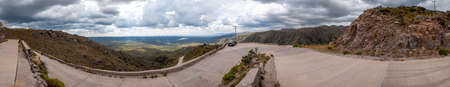 Panorama of the golds road, San Luis, Argentina, which climbs steppe mountains and big lakes with curvy ascending ways