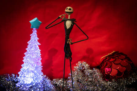 Charming Jack Skellington from Night Before Christmas surrounded by festive adornments in a red background