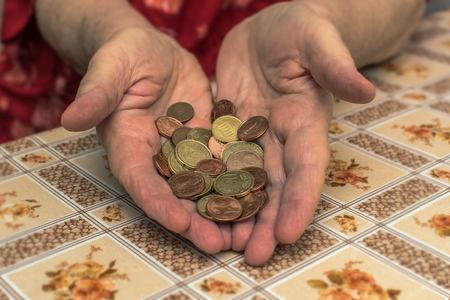Old people often have financial problems. You have to count on every penny. Hands of an old woman (65-80 years) with the wherewithal. Concept: Money (EURO) 版權商用圖片