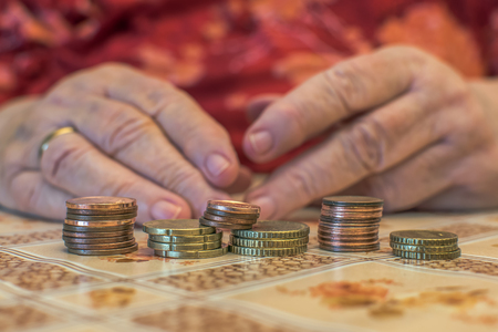 Old people often have financial problems. You have to count on every penny. Hands of an old woman (65-80 years) with the wherewithal. Concept: Money (EURO) Archivio Fotografico