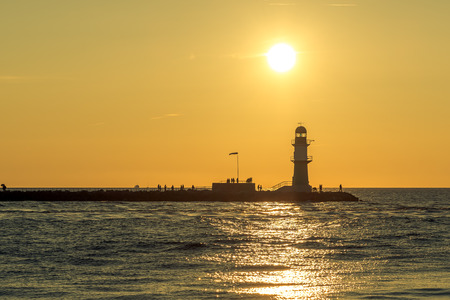 Sunset over the harbor entrance in Warnem?nde on the Baltic Sea. Concept: travel and vacation