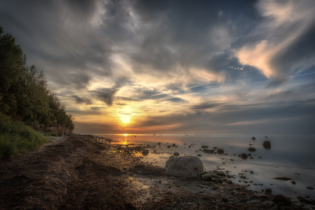 A wonderful sunset on the Baltic coast. Concept: vacation and travel