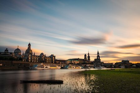 View of the oldtown of Dresden from the Neustädter Elbufer, with some of its main buildings to be recognised, including the Frauenkirche, the Cathedral or the Albertina. Long exposure.