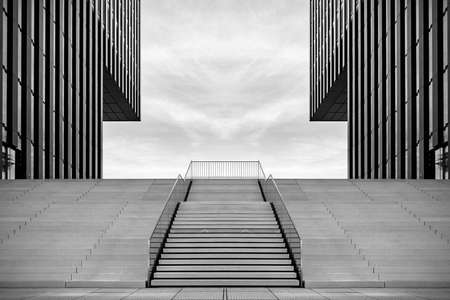 Wide stairway between two modern office buildings at the Medienhafen (media harbour) in Düsseldorf, Germany.