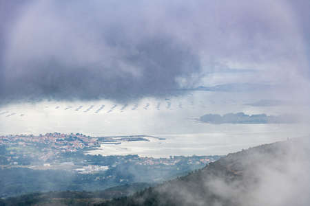 Aerial view of Rianxo on the Ria de Arousa estuary from the Muralla mountain on a foggy Summer afternoon.