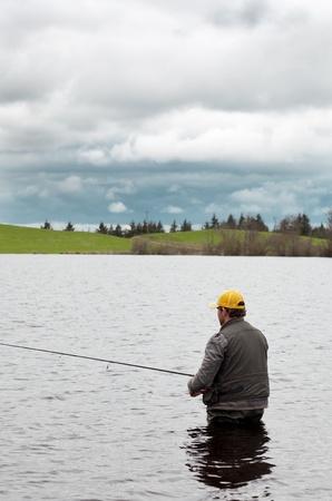 Angler fishing for pikes