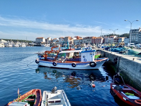 Fishing boats at port during summer in O Grove Spain on a nice sunny day