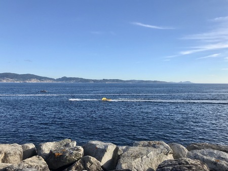 View from the pier with boats at the distance in Sanxenxo Galicia Spain during a sunny summer day