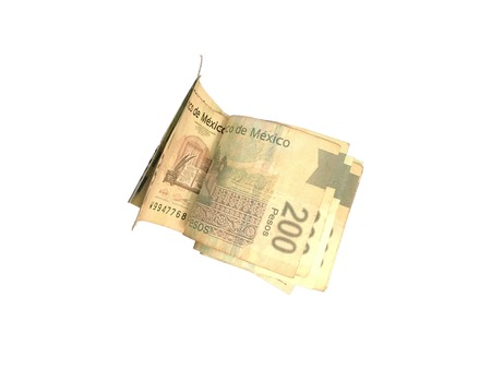 A bunch of mexican peso 200 paper bills grouped and isolated on white background