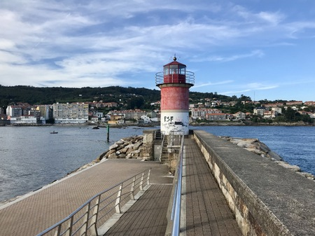 View of a lighthouse on the harbour of Sanxenxo Galicia Spain during a sunny summer day