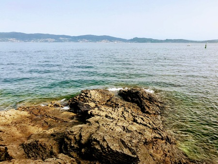 View of the ocean from above the rocks in Sanxenxo Galicia Spain during a summer day 免版税图像