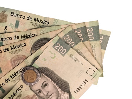 A bunch mexican peso 200 paper bills grouped and isolated on white background Stock fotó