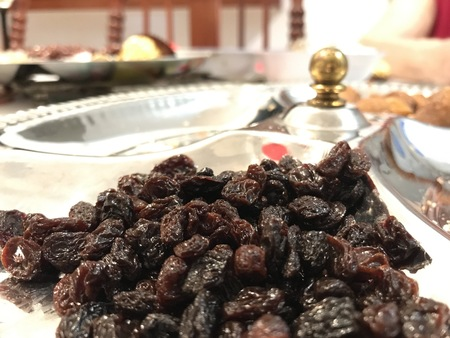 Grapes raisins on a stainless steel tray during the Christmas dinner.