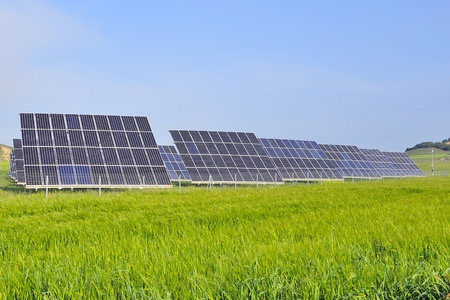 fuel cell: silicon solar energy batteries on green meadow
