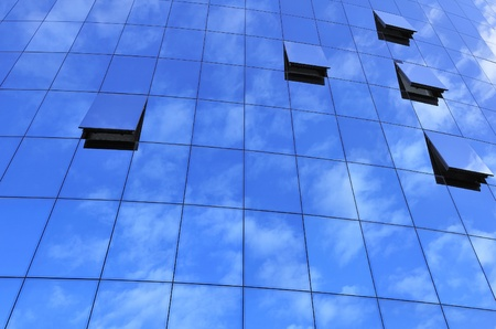 blue glass wall with windows and reflection photo
