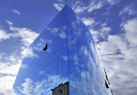 wall clouds: blue glass wall with windows and reflection