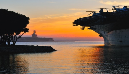 navy pier: aircraft carrier in harbour in sunset, San Diego, California Stock Photo