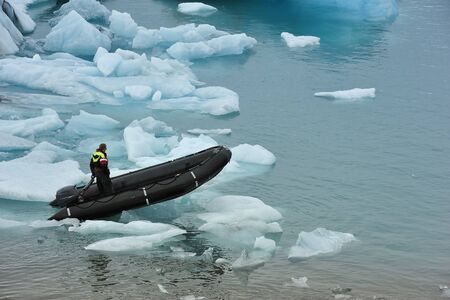 a boat on Ice Lagoon Jokulsarlon, Iceland photo