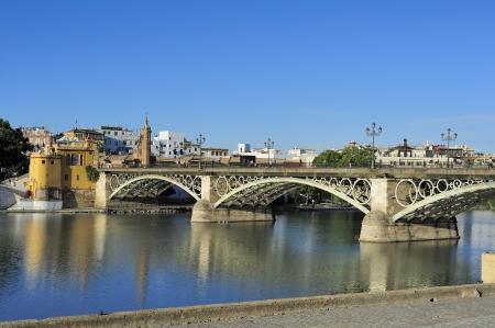 Isabel II bridge  Triana Bridge  built in 1852 crossing the Guadalquivir river in Seville, Spain