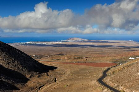 view at Valle del Pozo from the 450m high at Femes, Lanzarote Island, Canary Islands, Spain Stock fotó